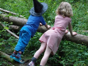 Richard and Ellie playing in woods, leaning on a branch, looking away. My useless new year's resolution