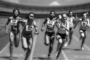 Black and white photo of six women competing in a sprinting race. Change it, or live with it?