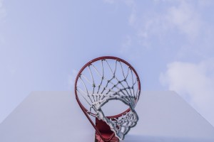 Looking up at a blue sky through a netball hoop. Shooting for the stars: my new self-belief
