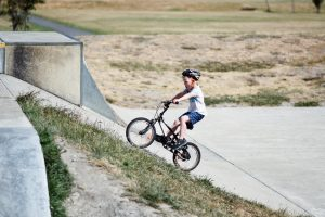 Boy on a bike on a concrete ramp.  Time: too much, too little, too late?