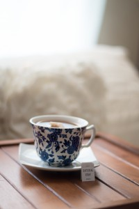 China cup and saucer, filled with tea.  Too many broken hearts, or china in your hand?