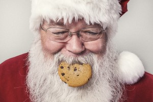 Father Christmas eating a cookie.  Unexpected guest this Christmas?
