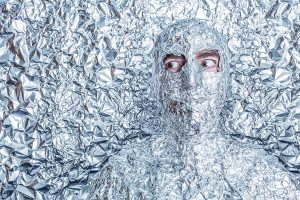 Man covered in tin foil, except his eyes.  Keeping everyone happy except me