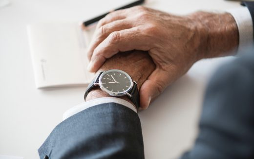 Mature man's hands with watch on arm. You'll have to make an appointment