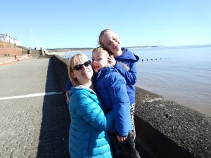 Mother, daughter and son having a hug on Bridlngton promenade. Sibling rivalry: too hot to handle?