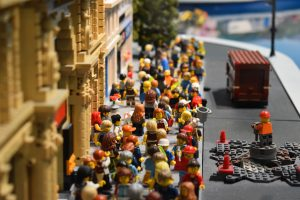 When would you press the pause button? Lego people walking up a street