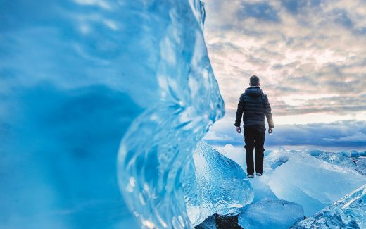 Man standing on frozen ice shapes. Conceal, or reveal?