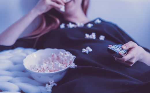 When would you press the pause button? Lady on couch spilling popcorn on herself.