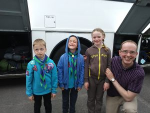 Two Beavers, one Brownie and a Dad ready to get on a coach. The joy of having the blues