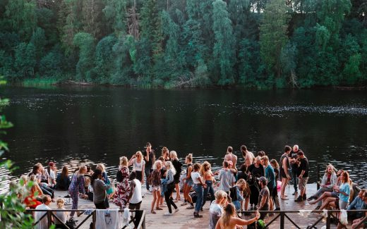 Group of people mingling in front of a lake. The joy of having the blues