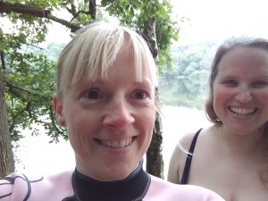 Two women in a selfie in front of a lake. Being rebellious, or going wild?