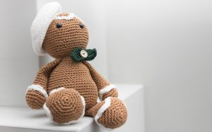 Brown croched teddy with a white background.  What do you take to bed: 5 tips for a better night's sleep