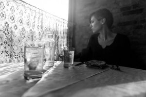 Woman at a meal table looking dissatisfied. What would your parallel universe look like?
