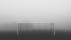 Football goal in the mist.  Shifting the goal posts