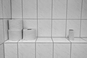 Toilet rolls in a bathroom.  Taking people as they are