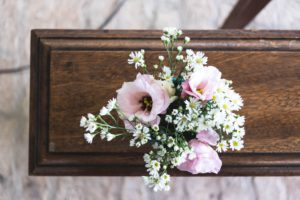 Pink and white flowers on the end of a wooden communion rail. What's that smell? 5 questions I didn't expect to be asked