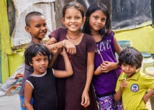 Four Indian children looking happy. What is your most worthwhile pursuit?