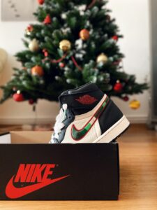 Nike trainer sticking out of a shoe box in front of a Christmas tree. What is your most worthwhile pursuit?