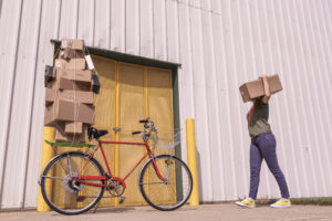 Bike piled high with boxes. Possessions: what do you treasure the most?